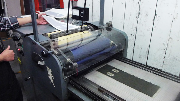 Our Vandercook press in action printing bellybands.