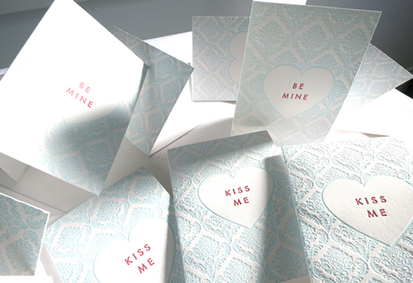 Whimsical piles of Valentine's cards created by Presse Dufour.