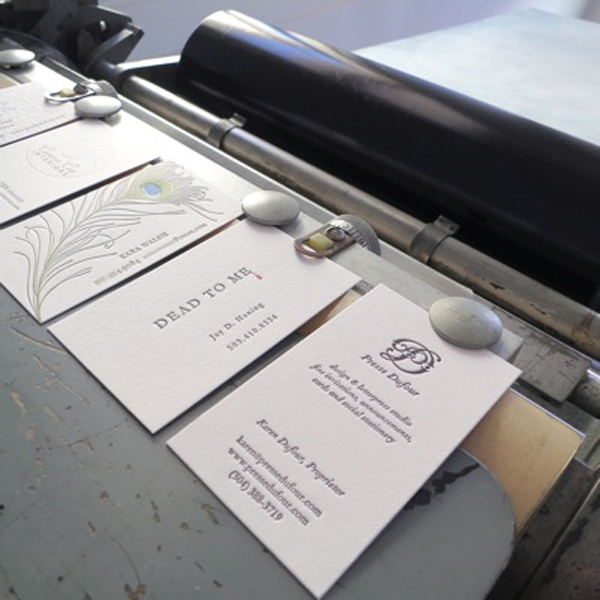 Lettepress cards on a Vandercook.