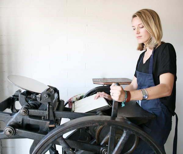 Laura Wentzel of Bears Eat Berries prints on her beloved letterpress printing press.