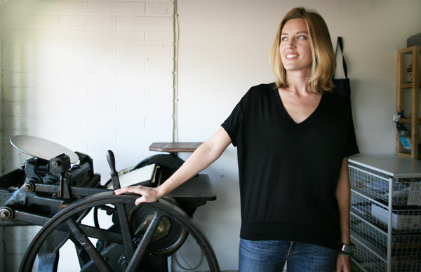 Laura Wentzel smiles on what letterpress adventures her Chandler and Price printing press will bring.