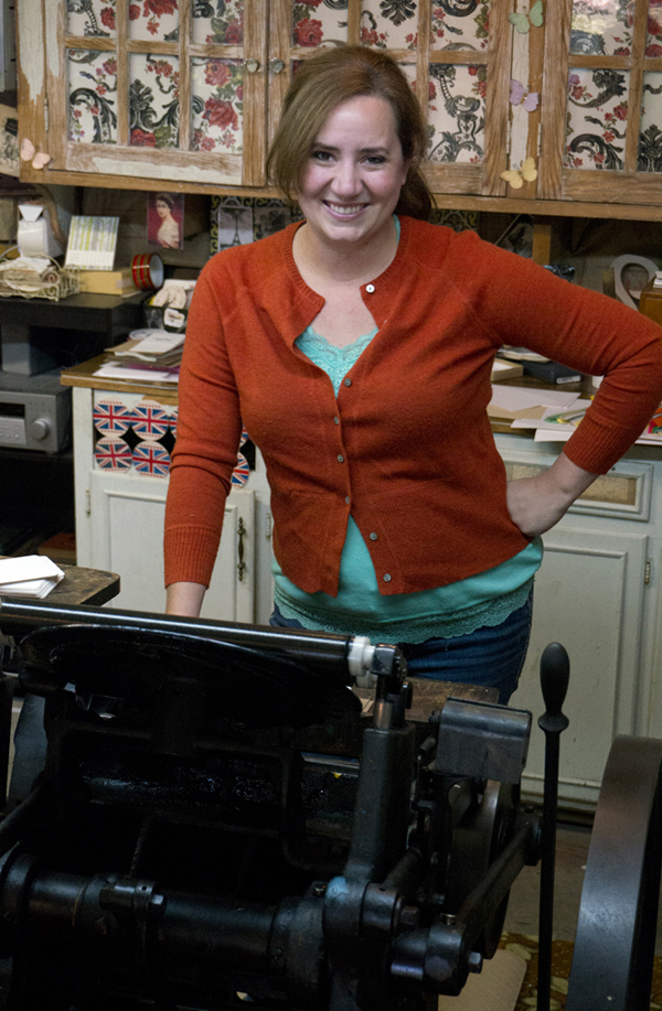 Sarah Ridgley of Pheasant Press with her beloved printing press.