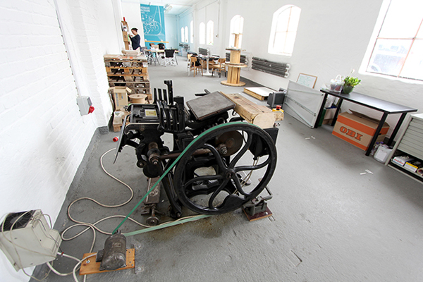 Clean spacious press floor of Absoloot letterpress printshop.