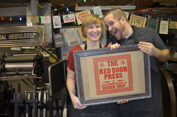 Tammy and Adam Winn of The Red Door Press are all smiles about letterpress!